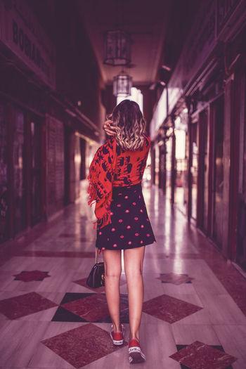 Full Length Rear View Of Woman Walking In Hotel Lobby