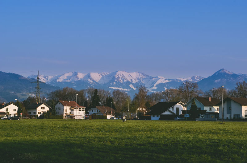 Architecture Beauty In Nature Blue Building Exterior Day Farmhouse Field Grass Landscape Mountain Mountain Range Nature No People Outdoors Rural Scene Scenics Sky Snow Tranquil Scene Tranquility Travel Destinations Copy Space