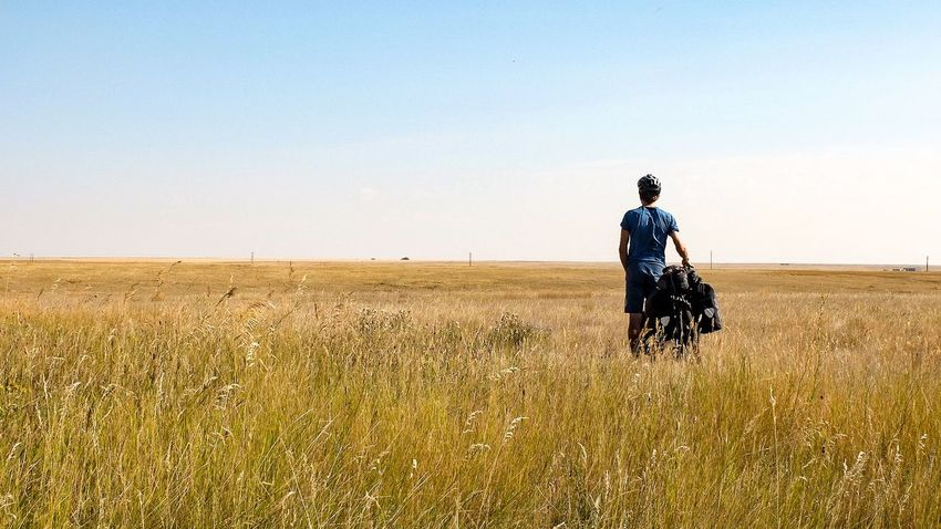 Cycling Trip  Solotraveler People Field Canada Coast To Coast Outdoors Wheat Field Agriculture Rural Scene Field Cyclist Cyclists In Landscape