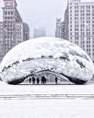Digital composite image of people walking in city during winter