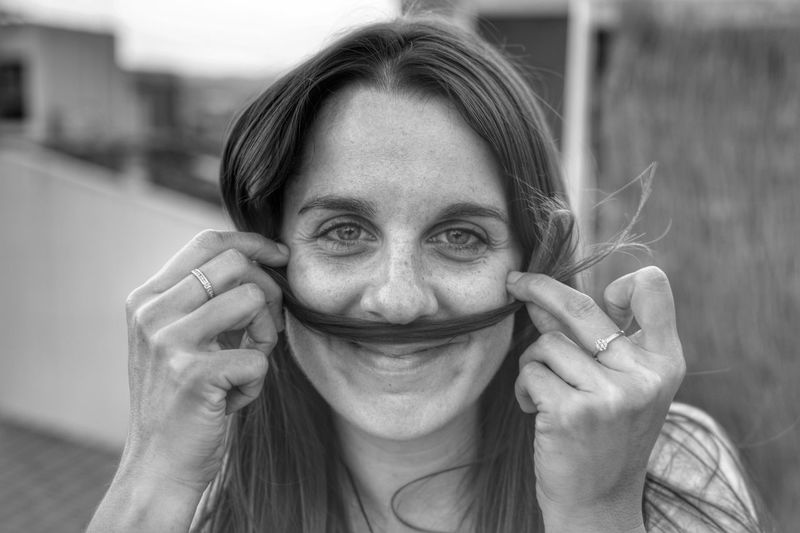 Portrait Of Woman Making Mustache With Her Hair