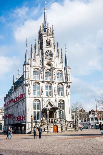 Building Exterior Architecture Built Structure City Sky Large Group Of People Real People Travel Destinations Place Of Worship Outdoors Spirituality Religion Low Angle View Day Clock Tower Townhall Holland Gouda Historical Building The Netherlands City Old Town Monument My Favorite Picture  Cultures