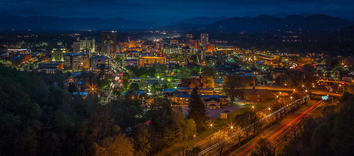 Panoramic shot of illuminated cityscape at night