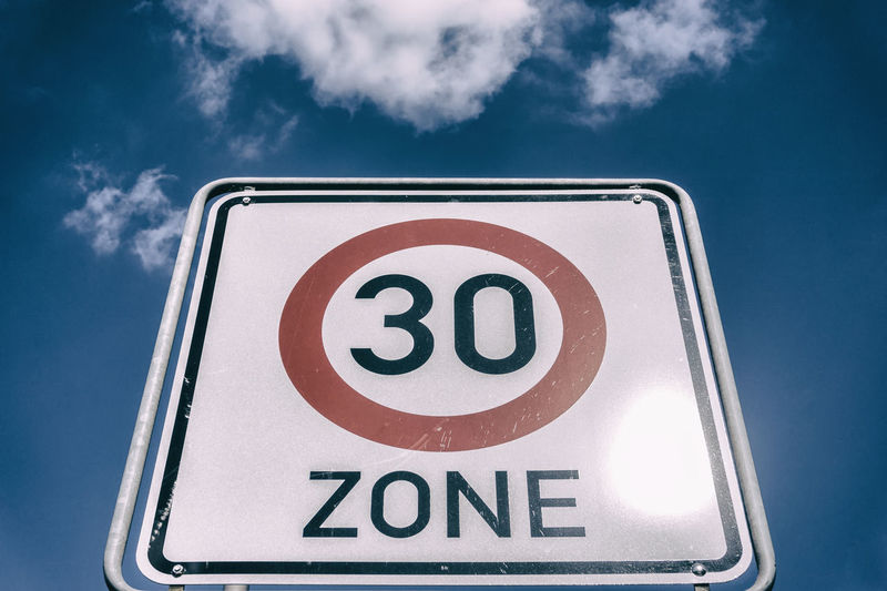 '30 Zone' traffic sign with clouds '30 Zone' Berlin Close-up Cloud - Sky Clouds And Sky Color Image Communication Day Germany 🇩🇪 Deutschland Guidance Horizontal Low Angle View Nature No People Outdoors Road Sign Sky Text Traffic Sign
