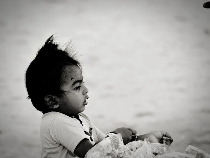 Close-up of baby boy at beach
