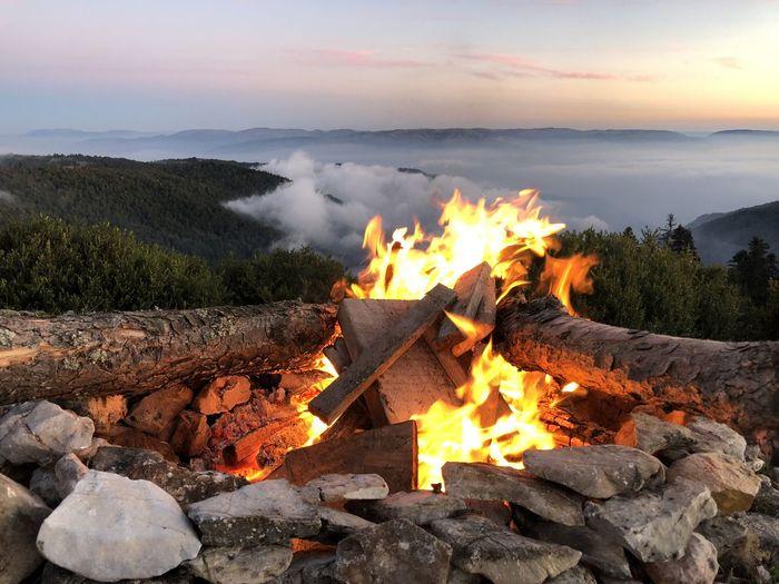 Bonfire against sky during sunset