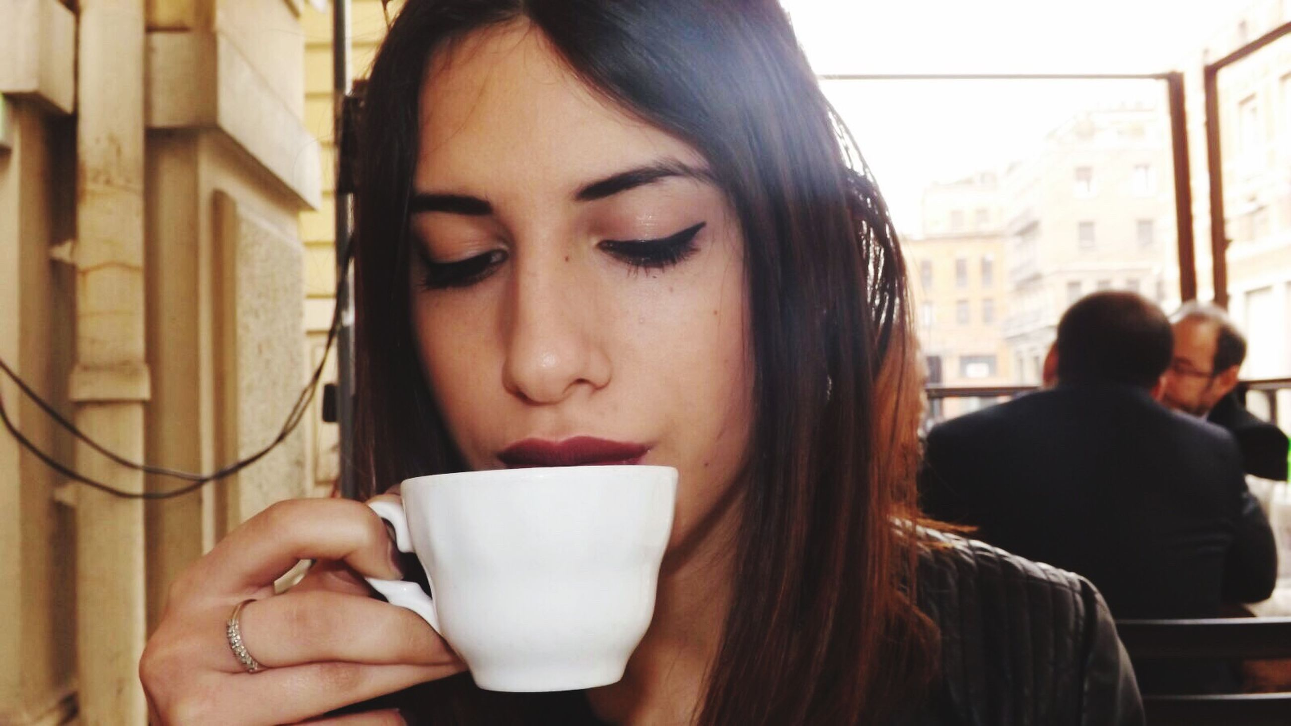 coffee - drink, coffee cup, young women, drink, drinking, real people, headshot, young adult, leisure activity, holding, lifestyles, women, cup, refreshment, one person, depression - sadness, coffee break, close-up, adult, only women, people, day, indoors, adults only, latte