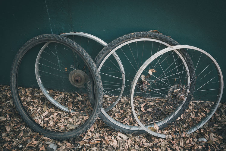 Old bicycle wheels were discarded Wagon Wheel Spoke Tire Run-down Deterioration Decline Land High Angle View Stationary Damaged Nature Bicycle Old Outdoors Obsolete Abandoned Day No People Land Vehicle Mode Of Transportation Metal Wheel Transportation Close-up