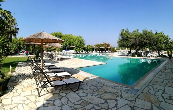 Swimming Pool Water Outdoors Tree Day Sky Summer Time  Holidays In Greece ❤ Holiday Poolsideview