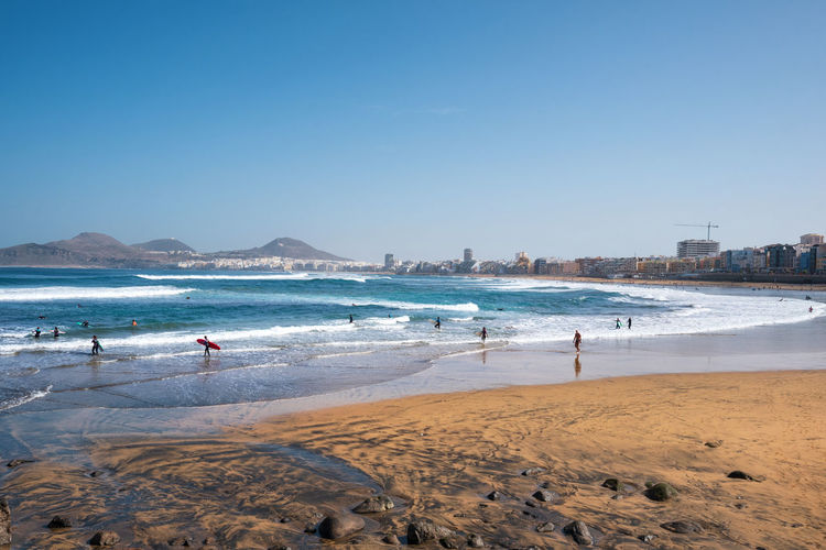 Las Canteras beach in Grand Canary, Canary Islands, Spain. Water Beach Sea Land Sky Sand Clear Sky Nature Day Copy Space Wave Beauty In Nature Incidental People Surfing Holiday Vacations Trip Scenics - Nature Sport Outdoors Grand Canary Gran Canaria Canary Islands