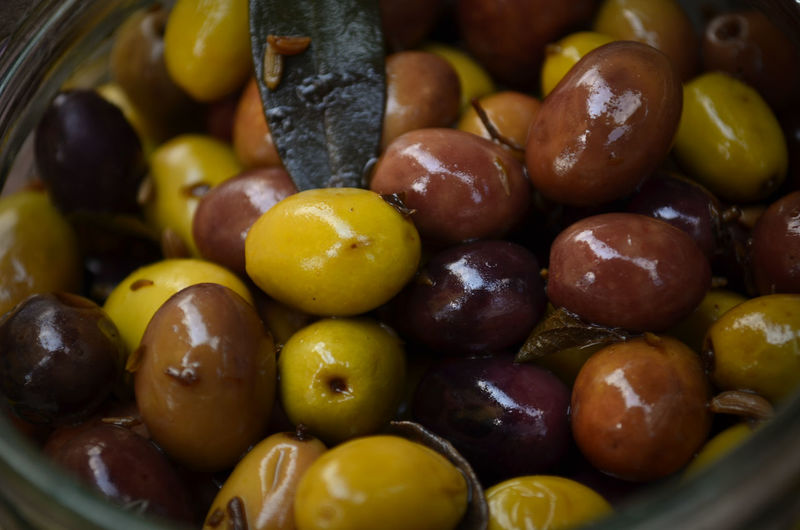 Close-up of pickled olives in jar