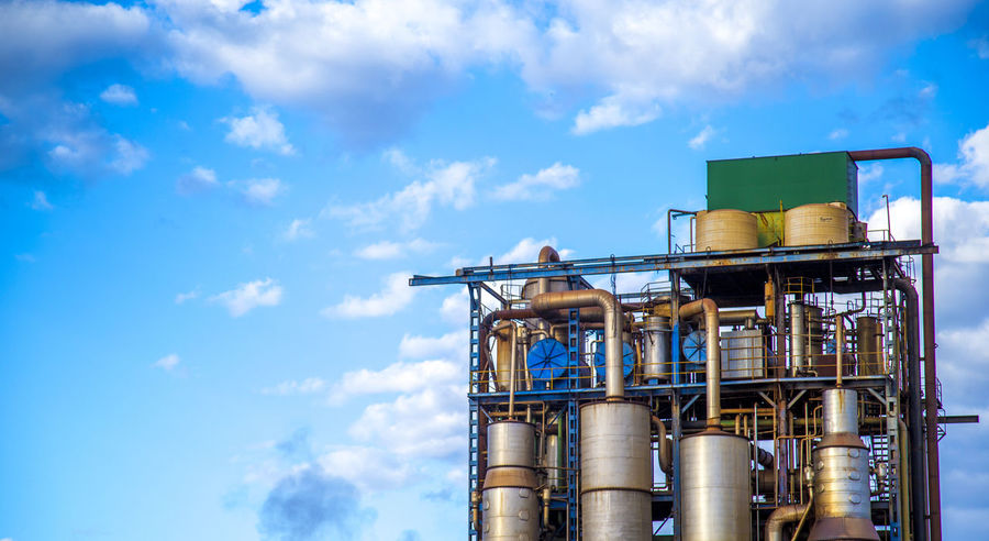 Destillery Alcohol Architecture Blue Building Exterior Built Structure Business Chemical Plant Cloud - Sky Day Factory Fuel And Power Generation Industrial Building  Industrial Equipment Industry Low Angle View Metal Nature No People Outdoors Silver Colored Sky Storage Compartment Sugar Cane Technology