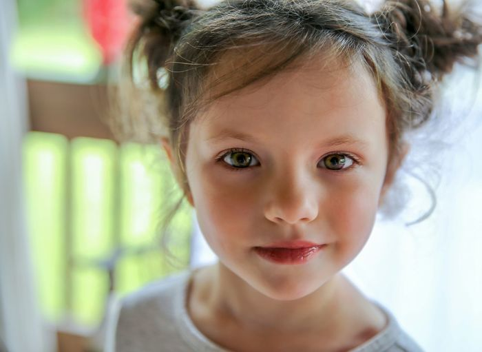 EyeEm Selects Portrait Child Childhood Smiling Girls Looking At Camera Headshot Human Face Human Eye Front View Eye Color Iris - Eye Complexion Hair Back