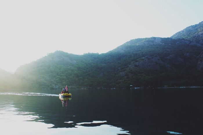 YES for adventure! Water Nature Beauty In Nature Real People Leisure Activity Mountain Sky Waterfront Mode Of Transport Lake Scenics Two People Outdoors Lifestyles Tranquility Nautical Vessel Day Clear Sky Finding New Frontiers
