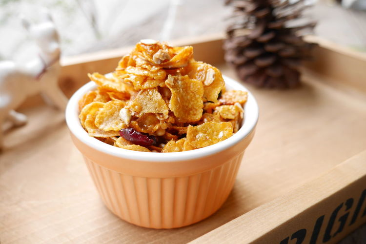 High Angle View Of Corn Flakes Cereal In Bowl On Table