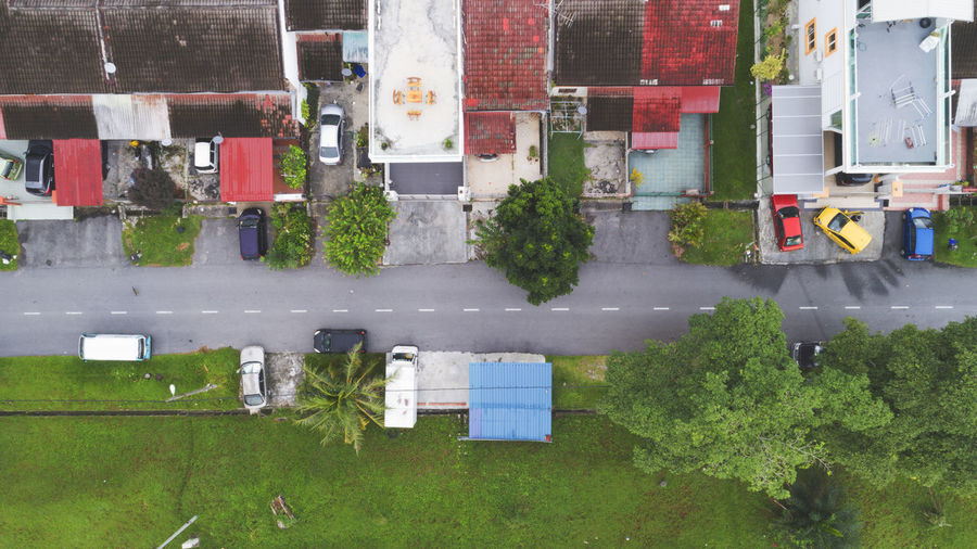 An aerial view of road, trees and roof top. Architecture Building Exterior City Day Growth No People Outdoors Variation View, Urban, City, Modern, Architecture, Top, Road, Town, Construction, Aerial, Downtown, Building, Traffic, Asia, Travel, Scene, Landmark, Office, Drone, Technology, Summer, Intersection, House, Suburban, Land, Country, World, Above, Viewpoint, Urbanscap