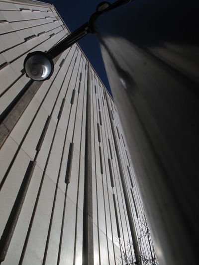 Low angle view of illuminated electric lamp