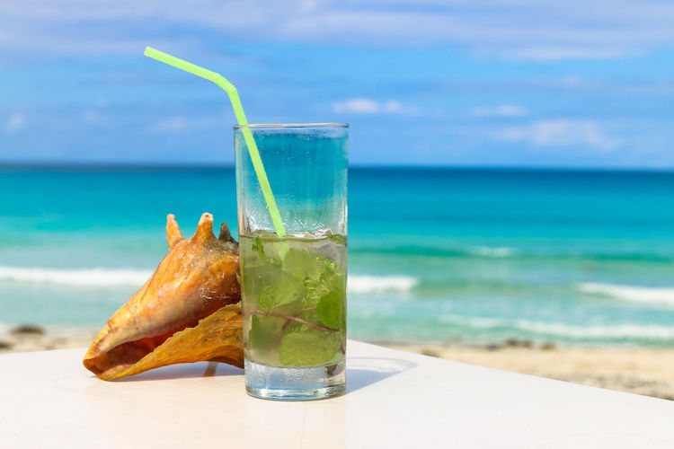 Ocean and mojitos, Cuba, Varadero Cocktail Cuba Cuba. Varadero Varadero Beach Beauty In Nature Cocktail Day Drink Drinking Glass Drinking Straw Focus On Foreground Food And Drink Freshness Horizon Over Water Mojito No People Outdoors Refreshment Sea Seashell Shell Sky Table Water My Best Travel Photo My Best Photo