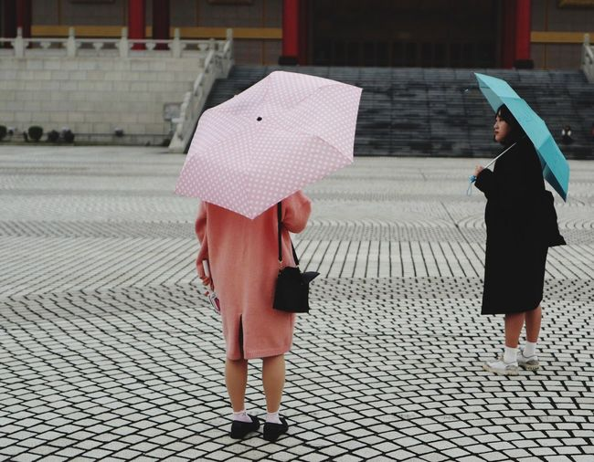 Women Standing With Umbrellas On Footpath At Chiang Kaishek Memorial Hall
