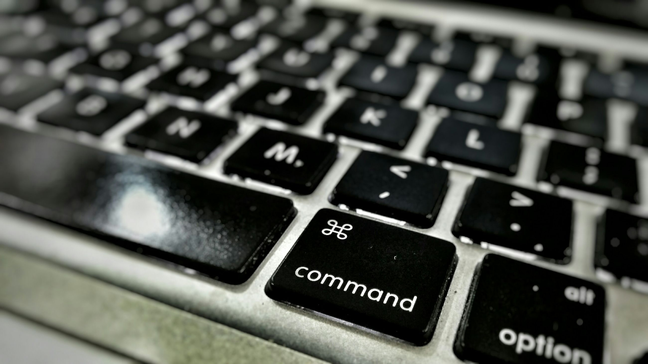 communication, indoors, text, number, computer keyboard, technology, western script, close-up, wireless technology, connection, alphabet, laptop, push button, control, selective focus, computer, capital letter, computer key, still life, computer equipment