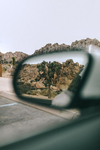 Close-up of view seen through side-view mirror