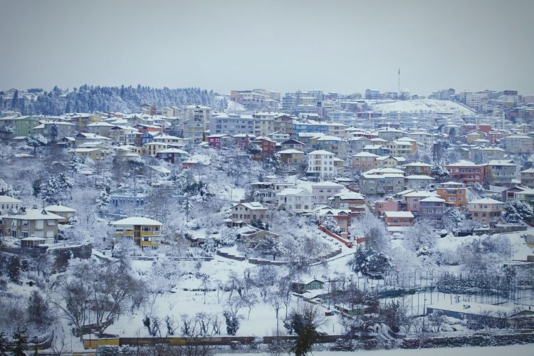 Aerial view of cityscape against clear sky during winter