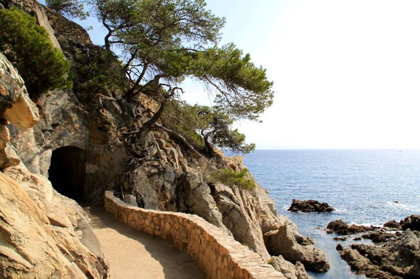 Lloret De Mar Path Walking Around Beauty In Nature Horizon Over Water Lloretdemar Nature No People Pathway Rock - Object Scenics Sea Tranquil Scene Tranquility Tunnel Water