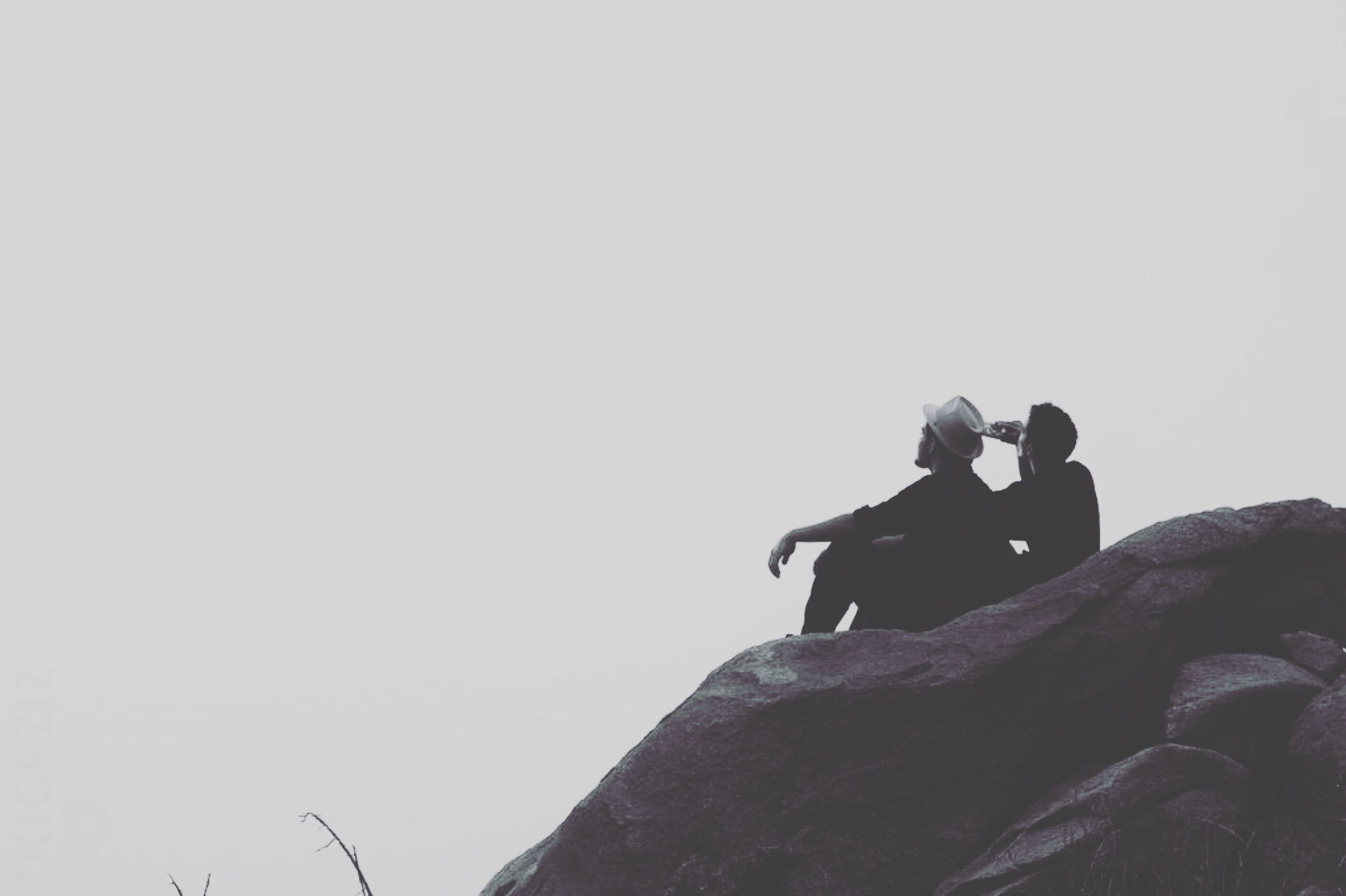 two people, sitting, leisure activity, outdoors, adults only, day, men, nature, people, togetherness, adult, sky, young adult, only men