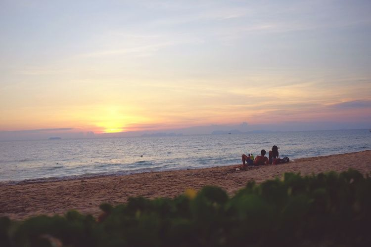 Sea Beach Sunset Horizon Over Water Nature Scenics Sand Water Shore Sky Real People Leisure Activity Vacations Tranquility Tranquil Scene Lifestyles Men Togetherness Silhouette The Great Outdoors - 2017 EyeEm Awards
