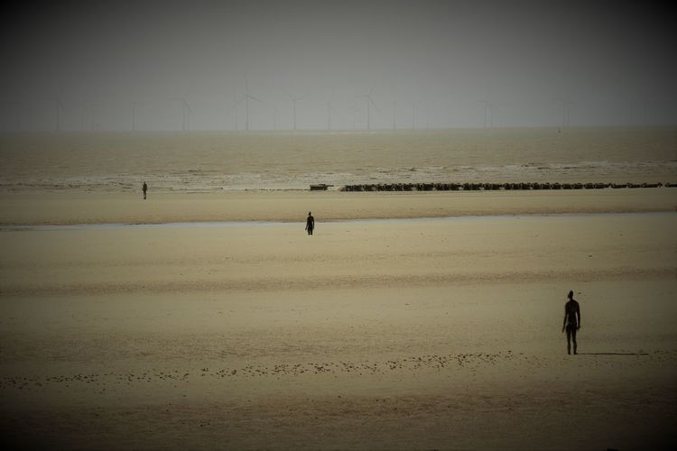 Another Place Another Place By Anthony Gormley Art Beach Beauty In Nature Contemplation Day Lonely Looking Out To Sea Nature On The Beach Outdoors Sand Scenics Sculpture Sea Seascape Sky Standing Water