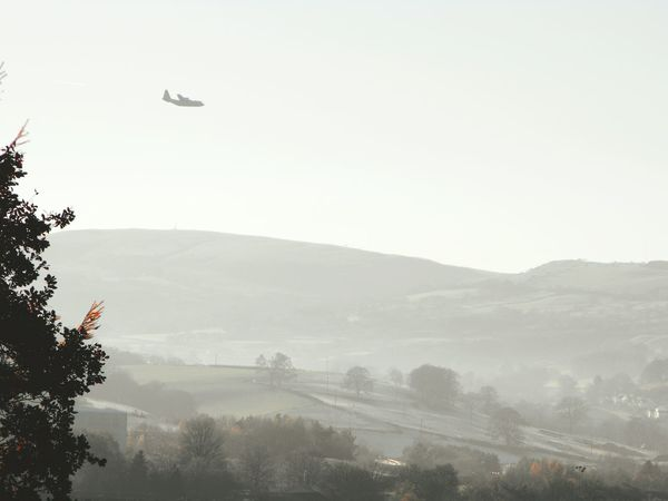 ... being Photobombed in Newtown Powys ... Flying Airplane Mountain Tree Outdoors No People Air Vehicle Sky Day Wales Typical Landscape Military Aircraft Low Flying Fog Haze Autumn Fall Miles Away