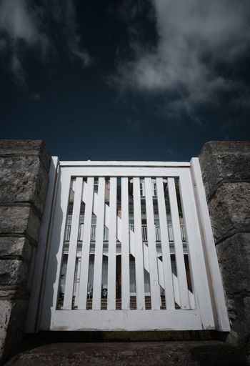 Low angle view of the gate against sky
