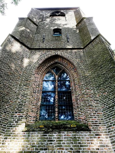 This beautiful reflection in this church window is just magic to me Brick Building Reflections Low Angle View Magicmoment Place Of Worship Exterior