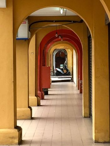 Series of Archways Arch Arches Architecture Archway Archways Balance Built Structure Colorful Corridor Hallway Multi Colored Penang Receding Repeating Symmetry Walkway Yellow