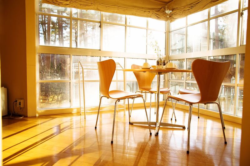 Empty chairs on table at home