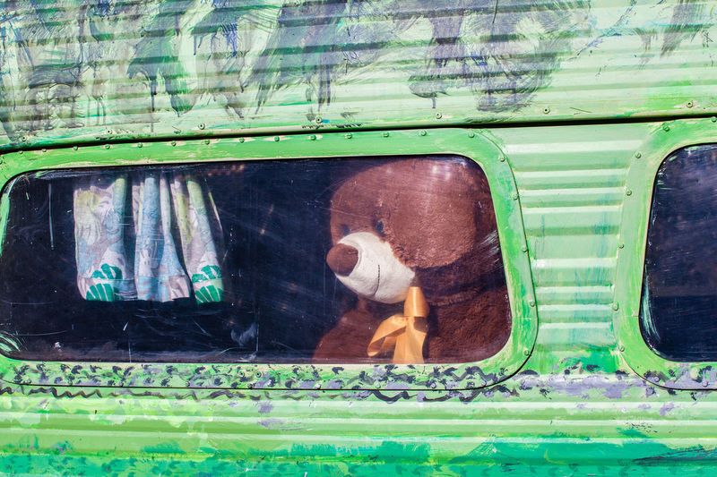 Teddy Bear In Motor Home Seen Through Window