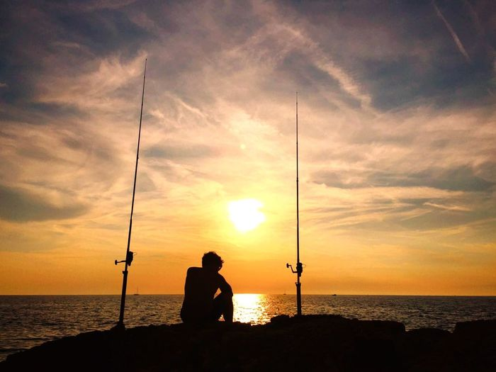 Sea Silhouette Fishing Water Fishing Rod Market Horizon Over Water Sunset Nature Tranquil Scene Real People Tranquility Weekend Activities Standing Rockfishing Sky Men One Person Scenics Idyllic EyeEmNewHere The Great Outdoors - 2017 EyeEm Awards EyeEm Selects Paint The Town Yellow