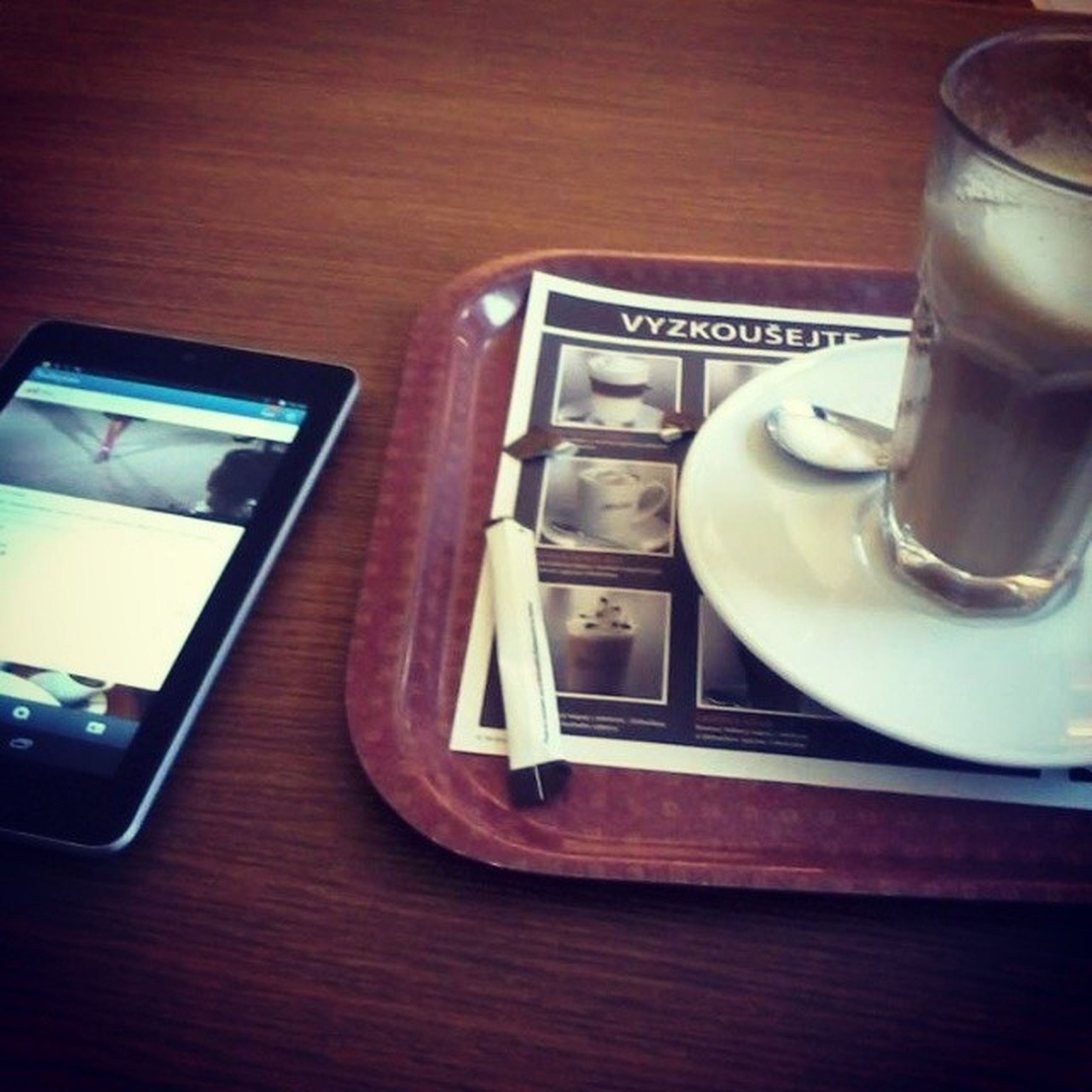 indoors, table, still life, close-up, communication, drink, no people, food and drink, technology, glass - material, coffee cup, reflection, wood - material, western script, refreshment, text, old-fashioned, retro styled, day, high angle view