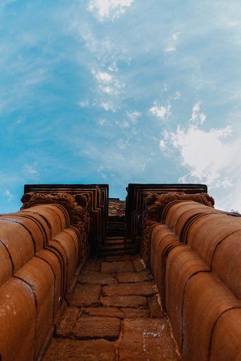 Architectural columns against sky