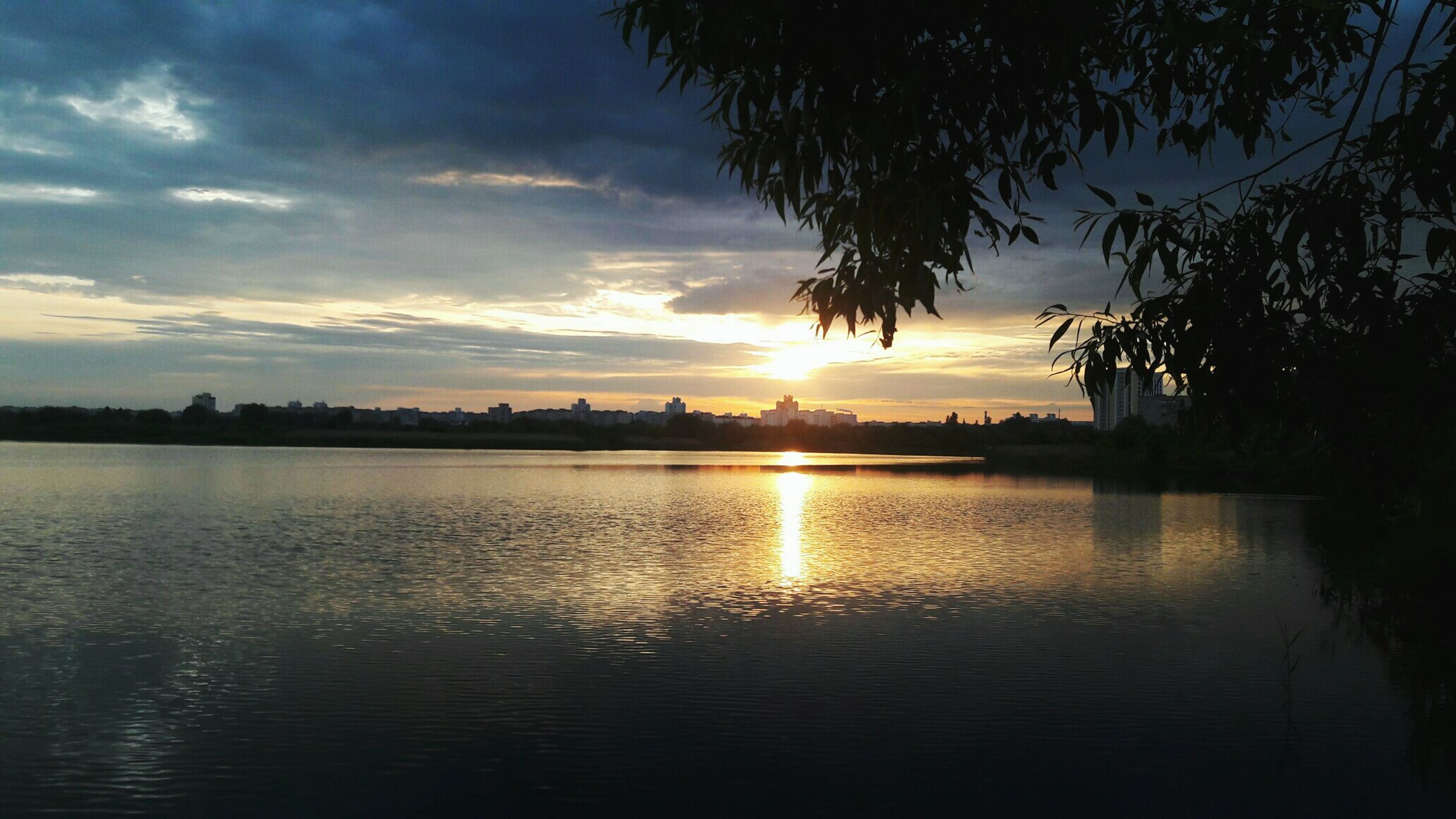 sunset, water, sky, reflection, tree, nature, palm tree, beauty in nature, outdoors, scenics, no people, cloud - sky, day