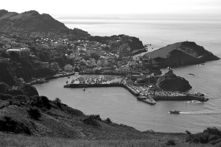 Architecture Beauty In Nature Blackandwhite Coastline Devon Distant England Harbor Harbour View Mountain Nature Non-urban Scene Outdoors Residential District Scenics Sea Shore Sky Tourism Town Tranquil Scene Tranquility Travel Destinations Water