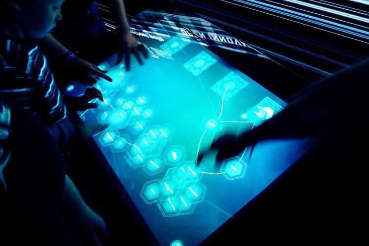 Human Meets Technology Touch Touching Screen Interface Interactive  Interaction Interactive Art Hand Hands On Boy Watching Blue Long Exposure multitouch... The Color Of Technology