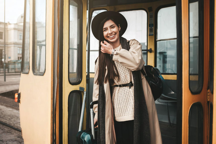 Portrait of smiling mid adult woman in train