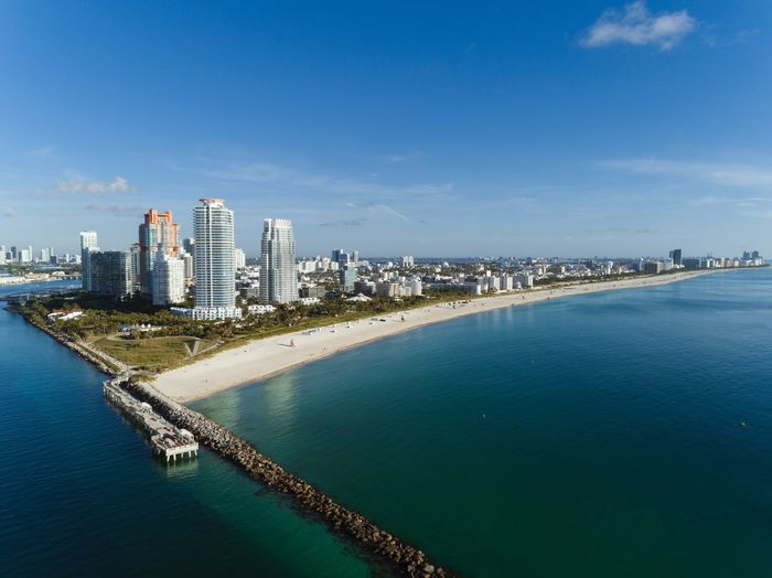 Wide view of Miami Beach Water Architecture Building Exterior City Built Structure Building Sky Blue Sea Waterfront Skyscraper No People Nature Cityscape Travel Destinations Residential District Urban Skyline Beach Outdoors