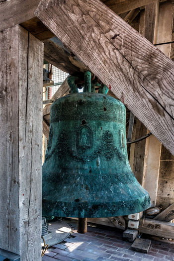 An old tower bell in Zadar. Croatia Zadar Animal Animal Themes Architecture Building Building Exterior Built Structure Day House Hut Log Cabin Nature No People Old Outdoors Residential District Roof Tower Bell Wood Wood - Material