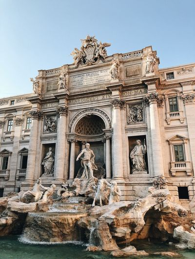 Rome TreviFountain Trevi Fountain Fountain Italia Italy Built Structure Architecture Sky Building Exterior History The Past Low Angle View Ancient Building Clear Sky Travel Destinations Travel Day Tourism Sunlight