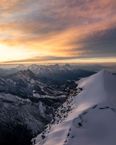 Cold Temperature Snow Winter Scenics - Nature Beauty In Nature Sky Mountain Cloud - Sky Sunset Tranquility Tranquil Scene Non-urban Scene Environment Nature Idyllic No People Mountain Range Landscape Frozen Snowcapped Mountain Outdoors Formation Mountain Peak