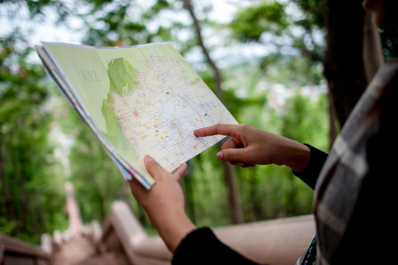 Midsection of woman reading map