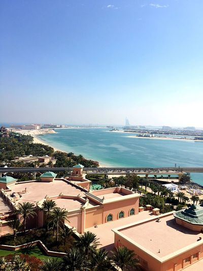 High Angle View Of Buildings At Palm Jumeirah By Sea Against Clear Sky