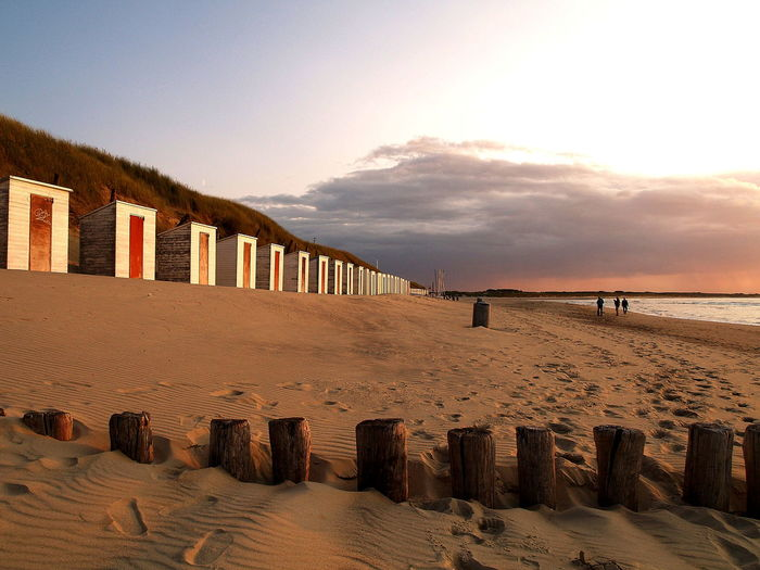 Beach Beach Cabins Diminishing Perspective Fence Horizon Over Water Human Settlement Leading Long Outdoors Pier Railing Scenics Sea Sky Sunset The Way Forward Tranquil Scene Tranquility Vacation Wood